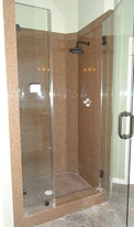 Bathroom Remodeling New Granite Shower with Bronze Showerhead and Glass Entry