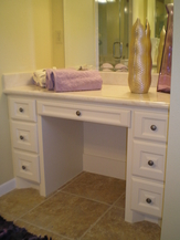 Bathroom Remodeling New Light Tan Solid Surface Sink Vanity with White Painted Cabinets, New Brushed Silver Hardware and Tan Tile Flooring