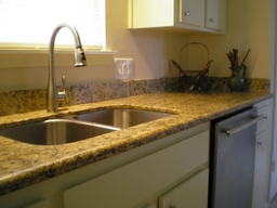 Kitchen Remodeling New Sink and Silver Pull Out Sprayer Faucet with Granite Countertops and New Dishwasher