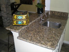 Wet Bar Project Picture with New Granite Countertop, Faucet, Sink, Cabinets, Drink Ledge and White Paint