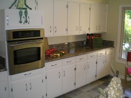 Kitchen Remodeling New Granite Countertops and Appliances with gas stove, New White Cabinet Paint and Hardware, New Kitchen Sink and Faucet. Kitchen Remodel. Kitchen Renovation.