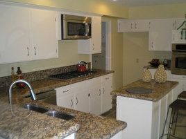 Kitchen Remodeling New Granite Countertops and Appliances with gas stove, New White Cabinet Paint and Hardware, New Kitchen Sink and Faucet