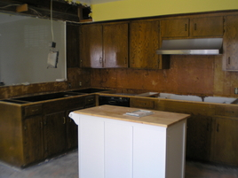 Kitchen Remodeling During. Removed old countertops and cook top. Removed lightening fixtures.