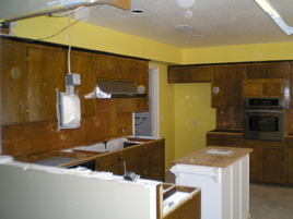 Kitchen Remodeling During. Removed old countertops and cook top. Removed lightening fixtures. Kitchen Renovation.
