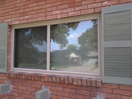 Replacement Window Almond Color Slider. Replacement Insulated Windows.