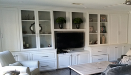 Home Remodeling Entertainment Center New Cabinets with Glass Doors. New White Paint and Hardware.