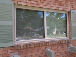Replacement Insulated Window Almond Slider Frame. After of Before and After.