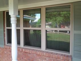 Home Remodeling Triple Single Windows in Almond