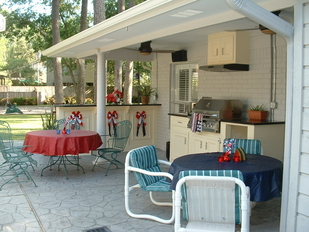 Outdoor Kitchen After Gas Grill with Side Burner, Cabinets, Exhaust Vent, Bar, Drop Lights, Fans and Speakers